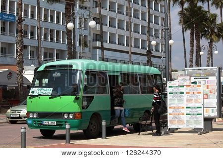 LARNACA, CYPRUS - MARCH 18, 2016: People at the intercity bus arrived to Finikoudes bus stop. Larnaca is the third largest city of Cyprus