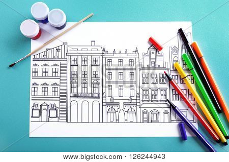 Adult anti stress coloring with soft tip pencils and paint closeup