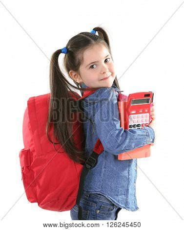 Little girl with red back pack holding books and stationery, isolated on white