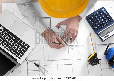Professional engineer working with blueprints