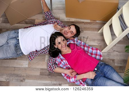 Young couple moving in new house. Top view.