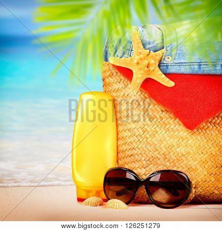 Beautiful still life of women's beach items on sandy seashore, tropical vacation, summer holidays concept