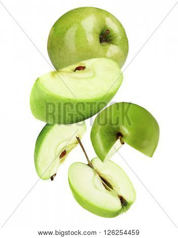 Falling ripe apples isolated on white
