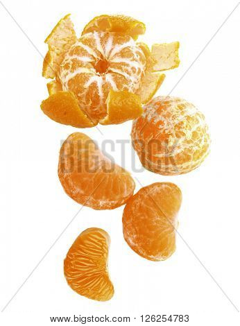 Falling tangerines isolated on white