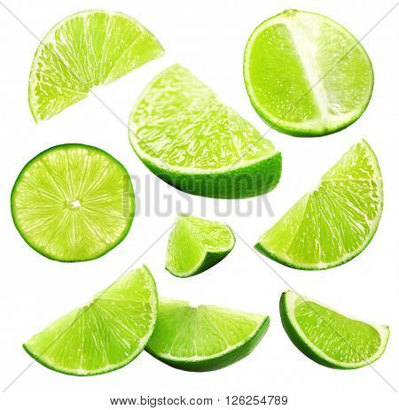 Falling limes isolated on white