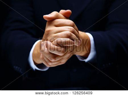 Praying hands on black backgroun