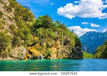 Stony slopes of canyon go down in azure the rivers Verdon. National park Merkantur, Provence