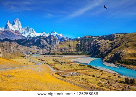 Amazing Patagonia. The white top of Fitzroy rocks covered the midday sun. The drying-up river in the valley of town of El Chalten