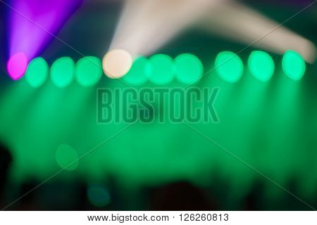 Blurred background Bokeh lighting in concert with audience Music showbiz concept vintage filtered image.