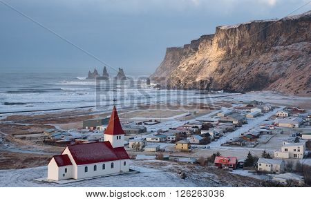 VIK, ICELAND - MARCH 28 2016: Vik Icelandic village in the Southeast Iceland covered in Snow in Spring.