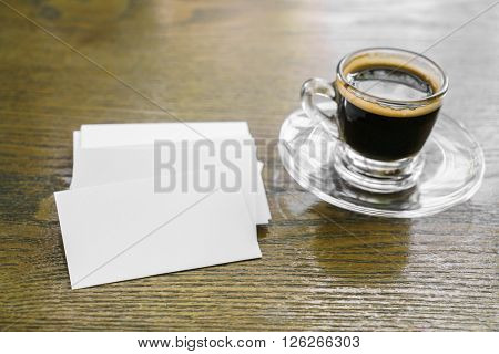 Business cards on wood table with coffee