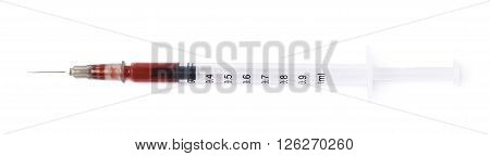 Medical syringe filled with blood, composition isolated over the white background