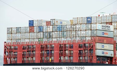 Oakland CA - April 08 2016:Rows of stacked shipping containers aboard MSC BRUNELLA at the Port of Oakland. Most modern container ships can carry up to 16020 twenty-foot equivalent units.