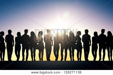 friendship, education and people concept - silhouettes of friends or students on stairs over sun