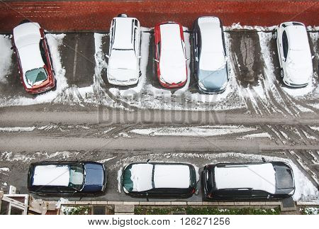 Cars Covered With Snow On The Parking Lot
