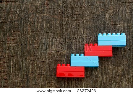 Plastic block stacking as step stair. Business concept for growth success process. Concept for corporate ladder.