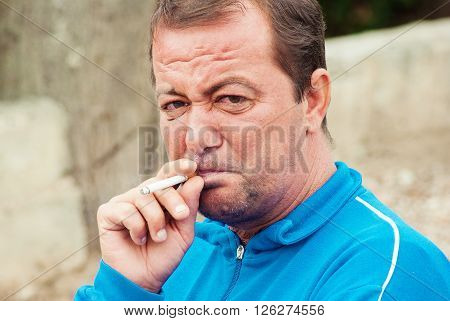 Senior Man Dressed In Formal Clothes Smoking Cigaretes