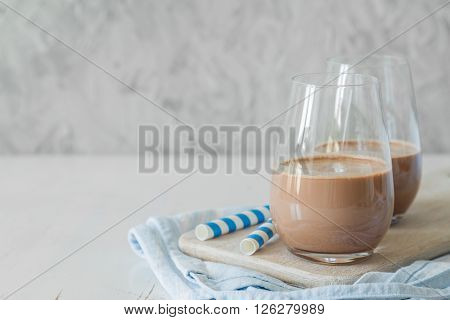 Cold chocolate milk in glasses, copy space