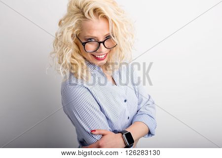 Flirty and funny woman looking over her glasses