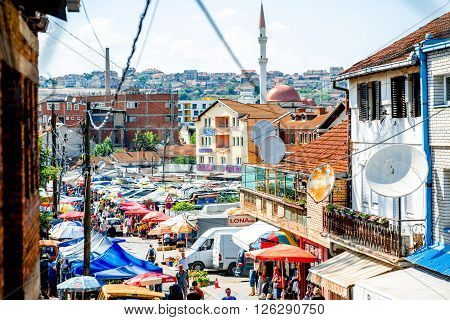 PRISTINA, KOSOVO - CIRCA JUNE 2015: Crowded market place on Ilir Konusheci street in Pristina the capital of Kosovo. Kosovo is a disputed territory and partially recognised state in Southeast Europe
