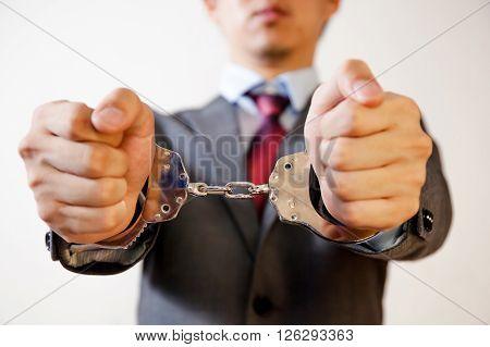 Business man criminal handcuffed - Business criminal debt burden concept