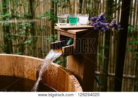 Onsen series : wooden bathtub with sample of mineral water