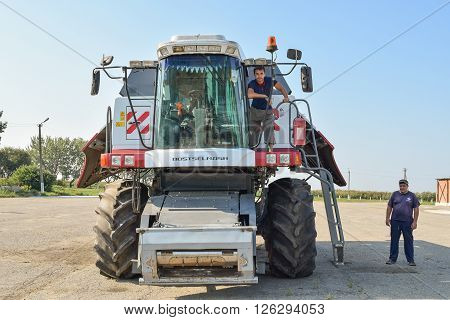 Russia, Poltavskaya village - September 6, 2015: Combine harvester combine operators with a parking lot. Agreecultural machines. Agreecultural equipment.