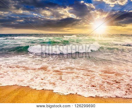 Sea ??waves Crashing On Sandy Beach  At Sunset