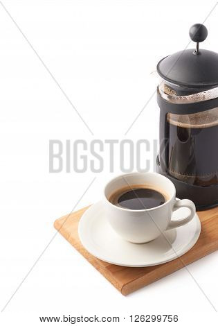 French press pot coffee maker and ceramic cup of coffee over the booden serving board, composition isolated over the white background and framed as a copyspace background composition