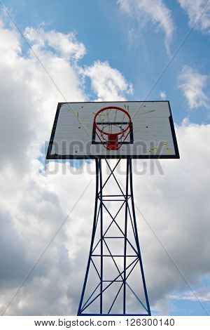 Old Worn Basketball Hoopand  Blue Sky