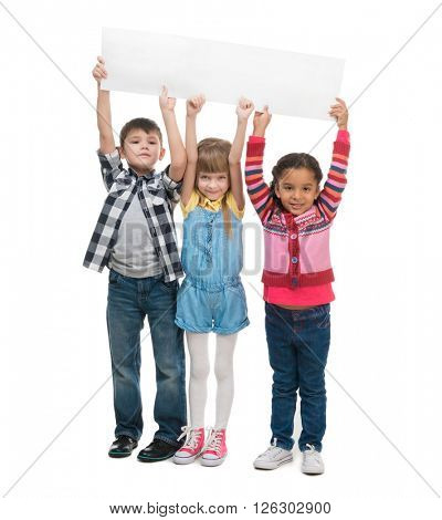 three children  holding empty sheet of paper isolated on white background