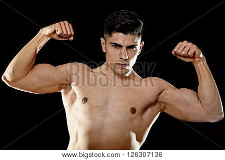 young handsome sport man posing with strong naked torso looking cool and defiant showing big shoulders and biceps in healthy lifestyle and gym club bodybuilding advertising concept poster