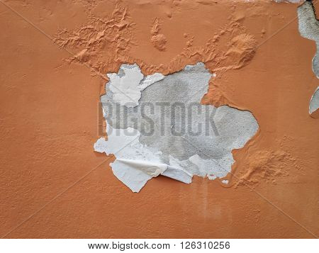 Deteriorated exterior paint of house orange colour  wall