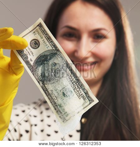 smiling beautiful young woman launder shady money (illegal cash dollars bill corruption manipulation)