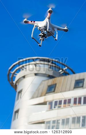 Hovering drone that takes pictures of city sights poster