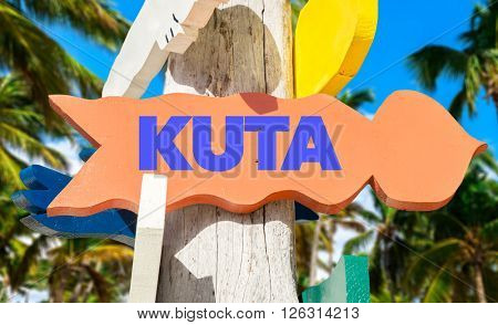 Kuta signpost with palm trees