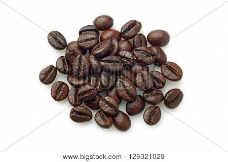 Pile of coffee beans (Robusta coffee) over white background. Overhead view.