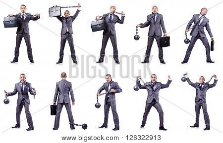 Businessman with shackles on white