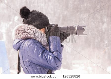 Young Girl Photographed In The Winter In A Snow Storm On A Slr Camera With Telephoto Lens