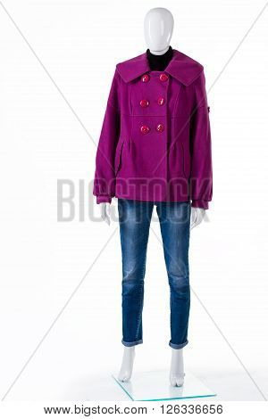 Purple coat with blue jeans. Mannequin wearing jeans and coat. Fleece outerwear for autumn. Lady's new coat on display.
