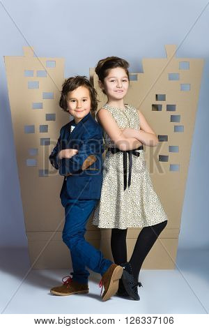 Boy and girl holding a cardboard town. Love concept.
