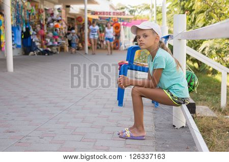 Tired Girl Sits About Six Years Of Trade Pavilions With Summer Goods