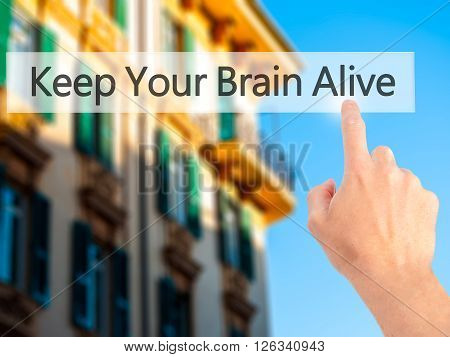 Keep Your Brain Alive - Hand Pressing A Button On Blurred Background Concept On Visual Screen.