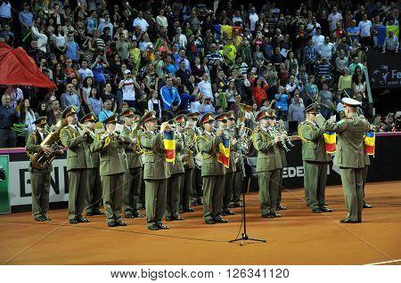 Beginning Of A Tennis Match. Crowd Singing National Anthem