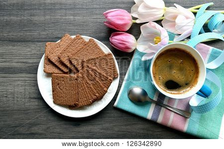 Coffee break with biscuit and beautiful flowers