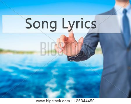 Song Lyrics - Businessman Hand Pressing Button On Touch Screen Interface.