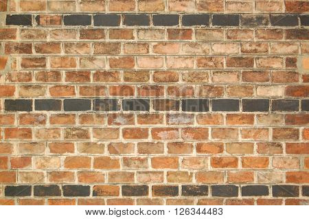 Shabby old brick wall, red and black bricks