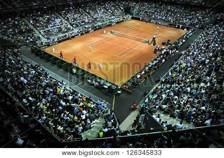 Crowd Of People In Sports Court During A Tennis Match