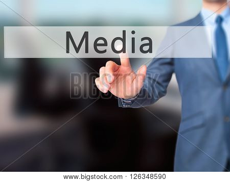 Media - Businessman Hand Pressing Button On Touch Screen Interface.