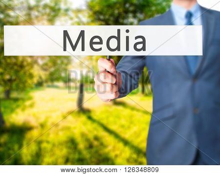 Media - Businessman Hand Holding Sign